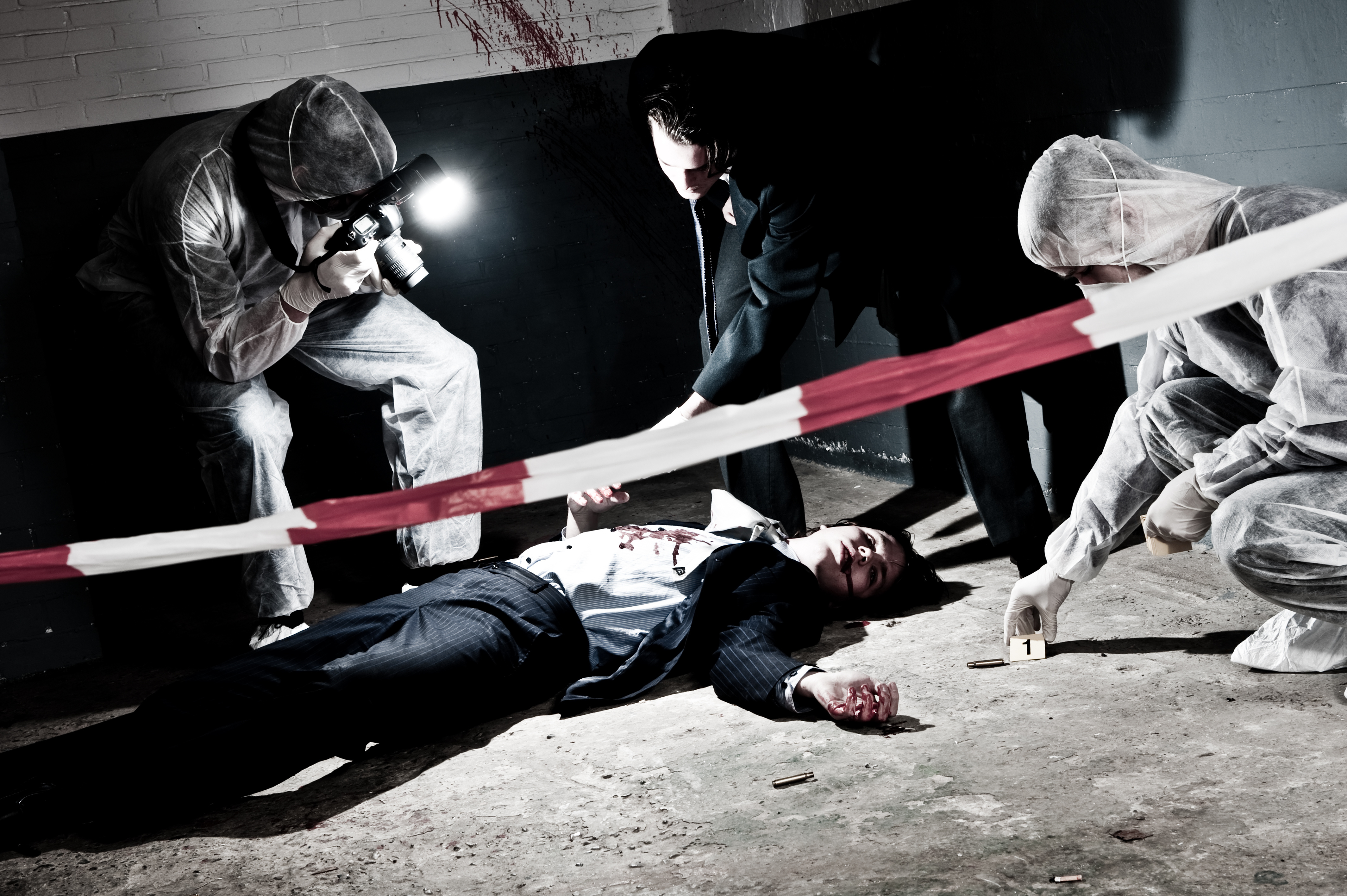 A cross processed murder scene with two forensic analysts and a police lieutenant investigating a crime on a businessman in a basementMurder scene with two forensic analysts and a police lieutenant investigating a crime on a businessman in a basement